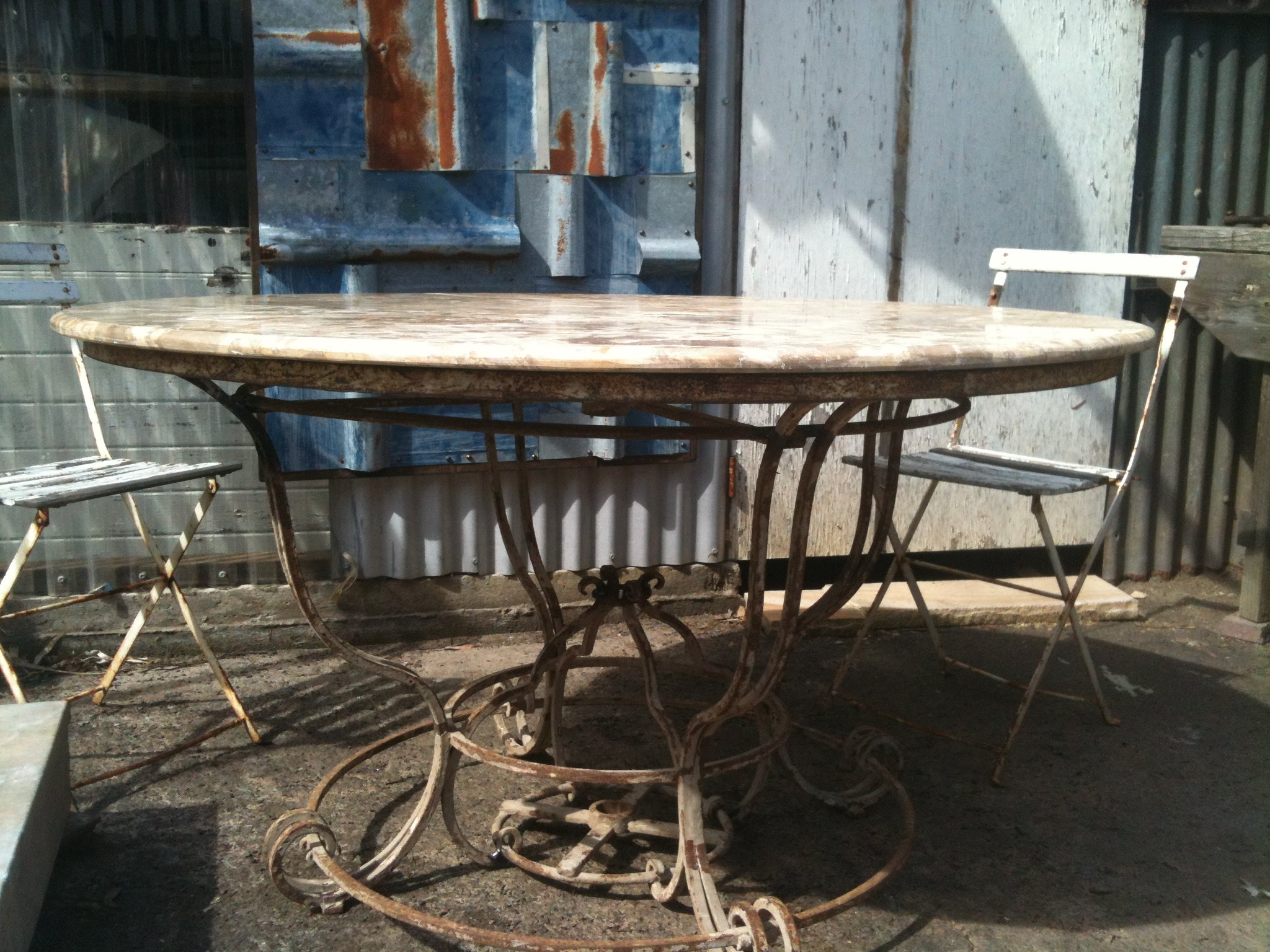 Superb Table Marble and Iron Base French Outdoor table Gorgeous original large round French outdoor table with elaborate iron base and a marble top